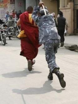 Nepalese police beat Tibetan monk